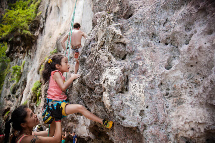 Kids rock climbing Krabi, Railay, Thailand